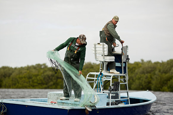 Father and son Shane and Mike Dooley fish for mullet. PHOTOGRAPHER BRIAN TIETZ
